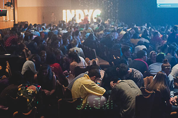 The conference ends by praying for the new year.
